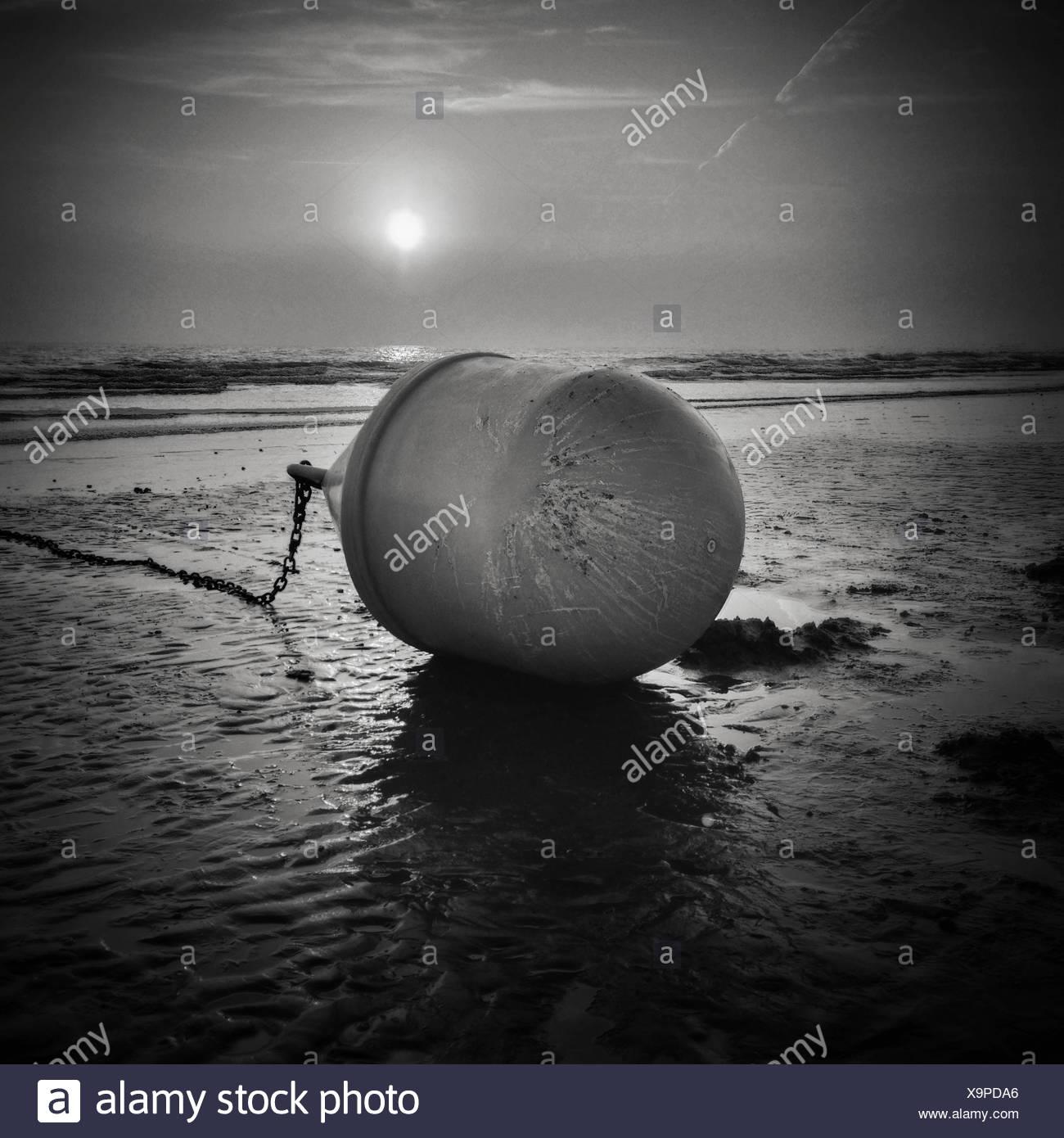 Buoy on beach - Stock Image