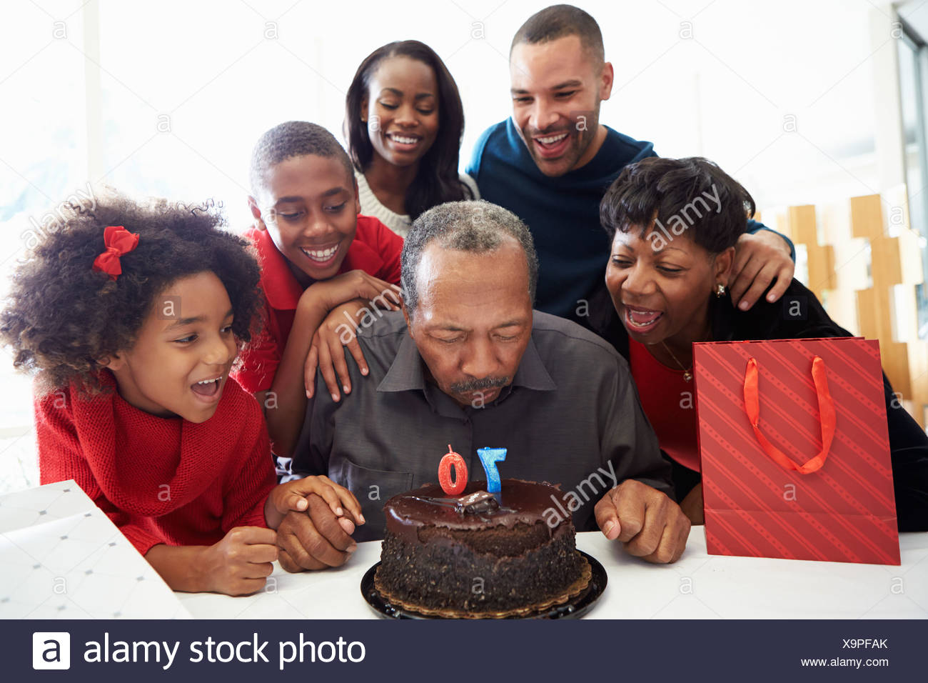 Family Celebrating 70th Birthday Together - Stock Image