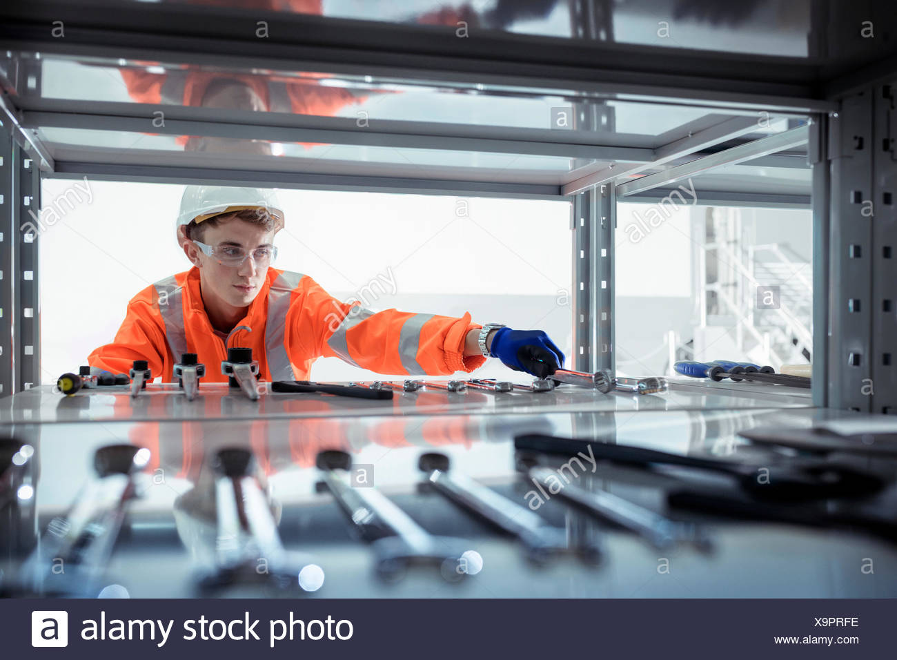 Apprentice selecting tools at railway engineering facility Stock Photo