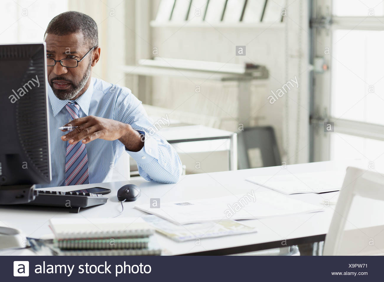 attractive middle aged man with confused look - Stock Image