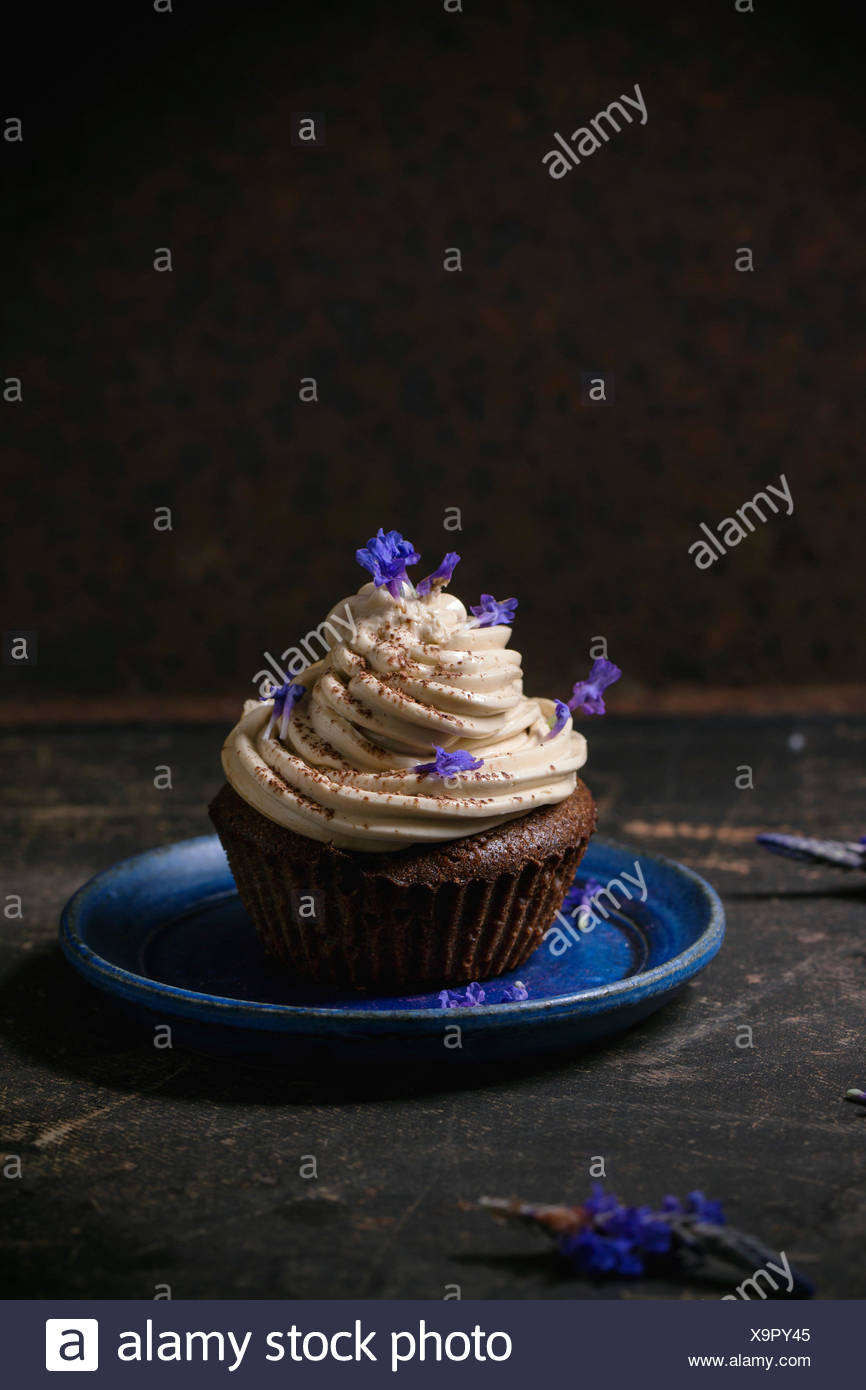 Blue Plate With Chocolate Muffin With Coffee Butter Cream And Edible