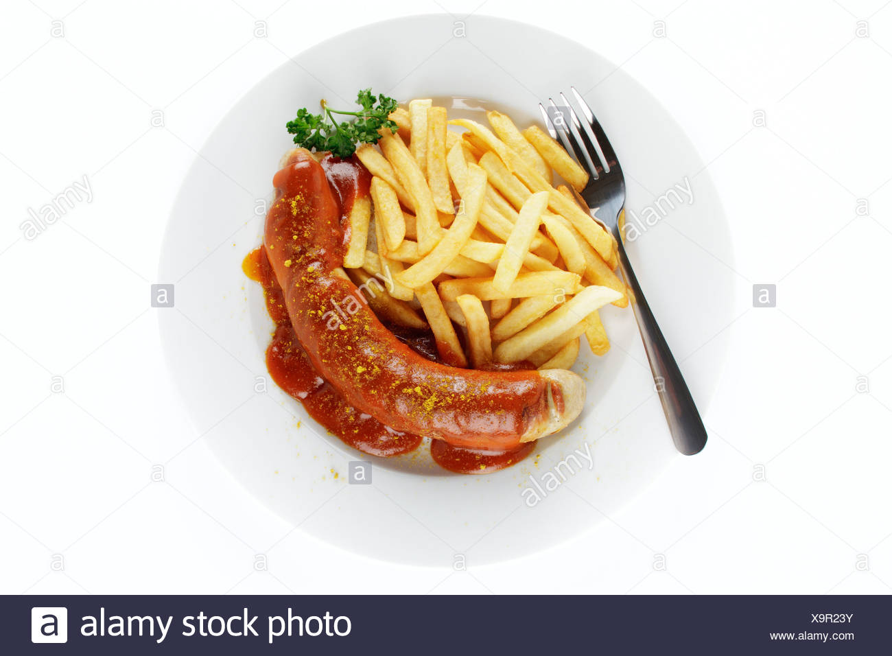 Sausage in curry sauce with French fries - Stock Image