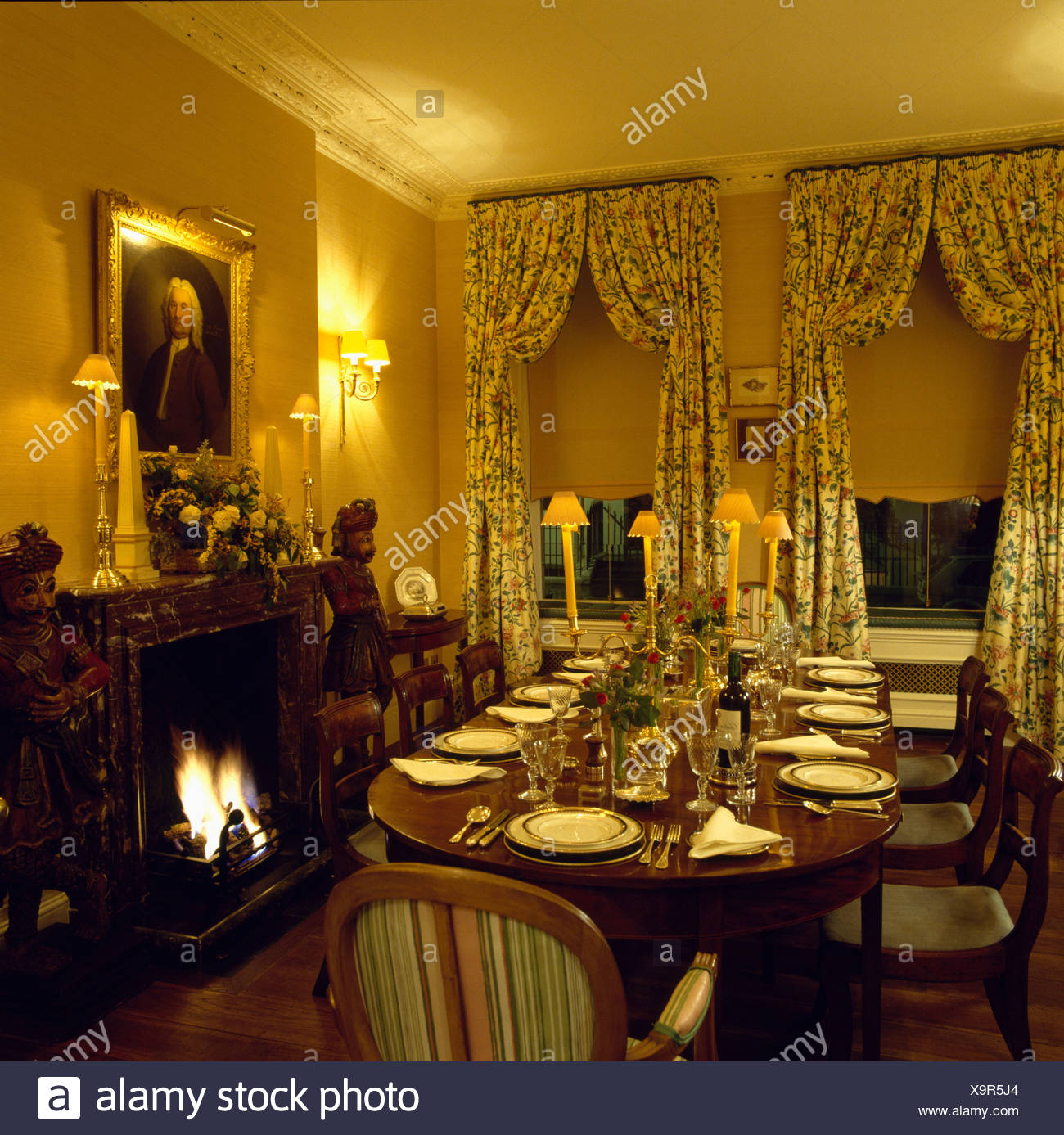 Antique Table In Yellow Dining Room With Blind And Floral Curtains