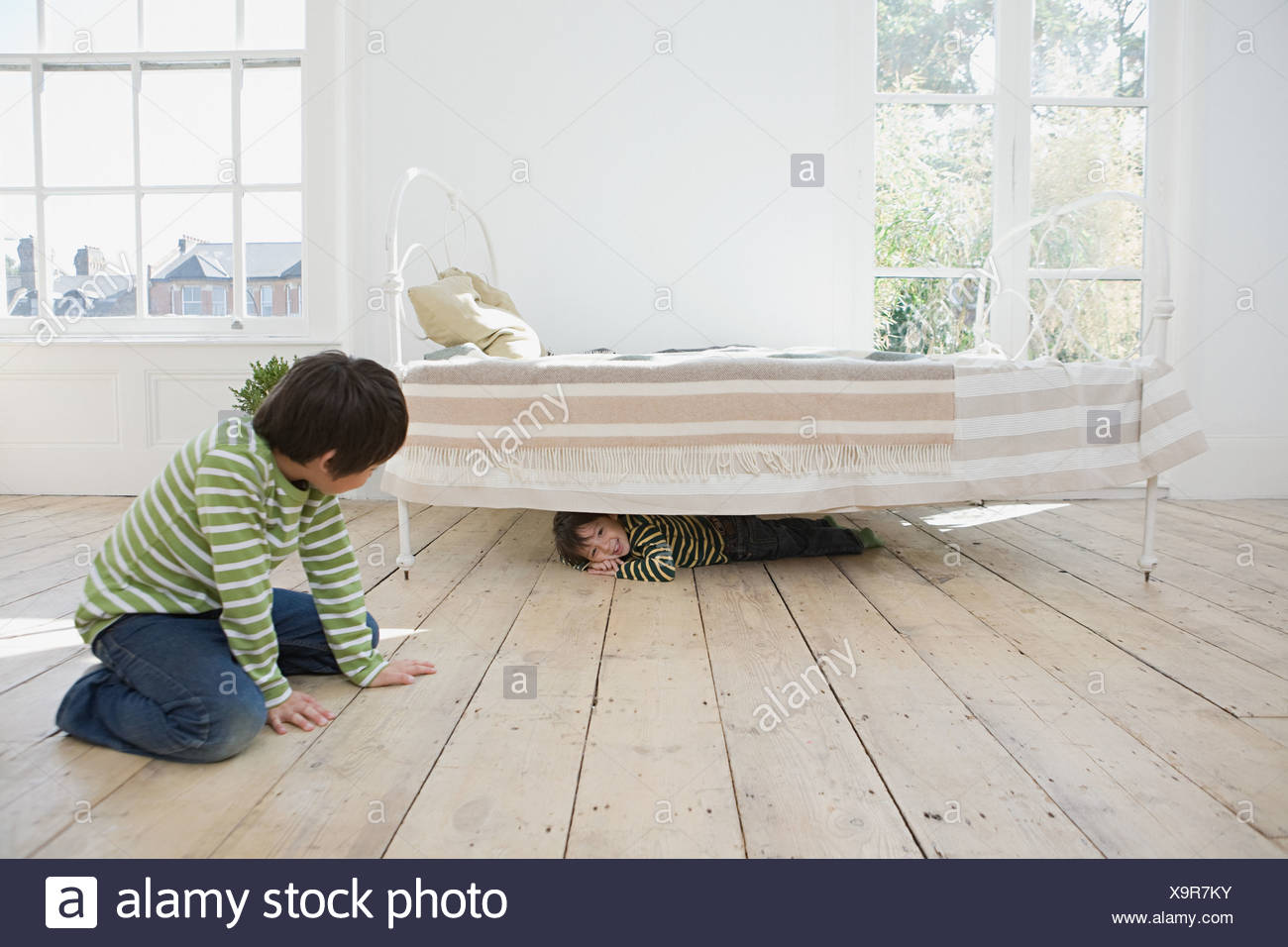 Boys playing hide and seek Stock Photo