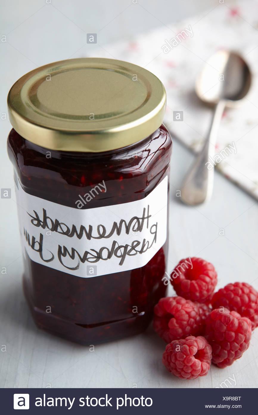 A still life of raspberry jam in jar - Stock Image