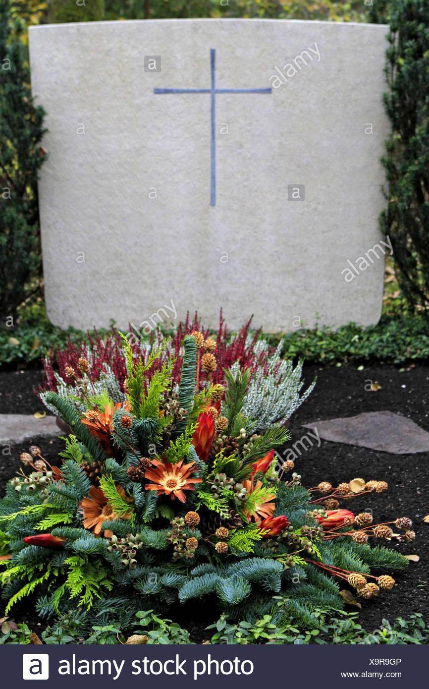 Geschmuecktes Grab auf einem Friedhof an Allerheiligen Stock Photo