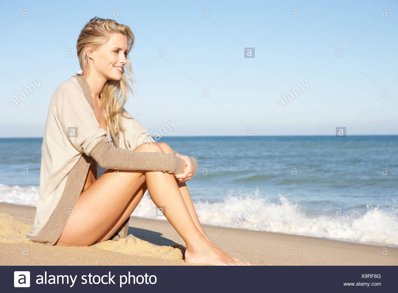 Young Woman Relaxing On Beach - Stock Image