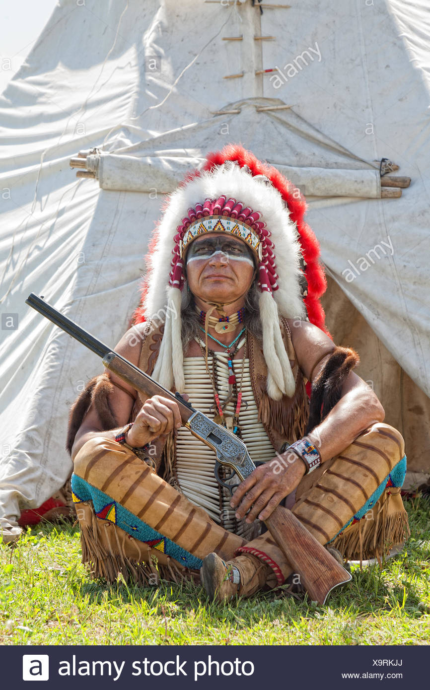 North American Indian in full dress. - Stock Image