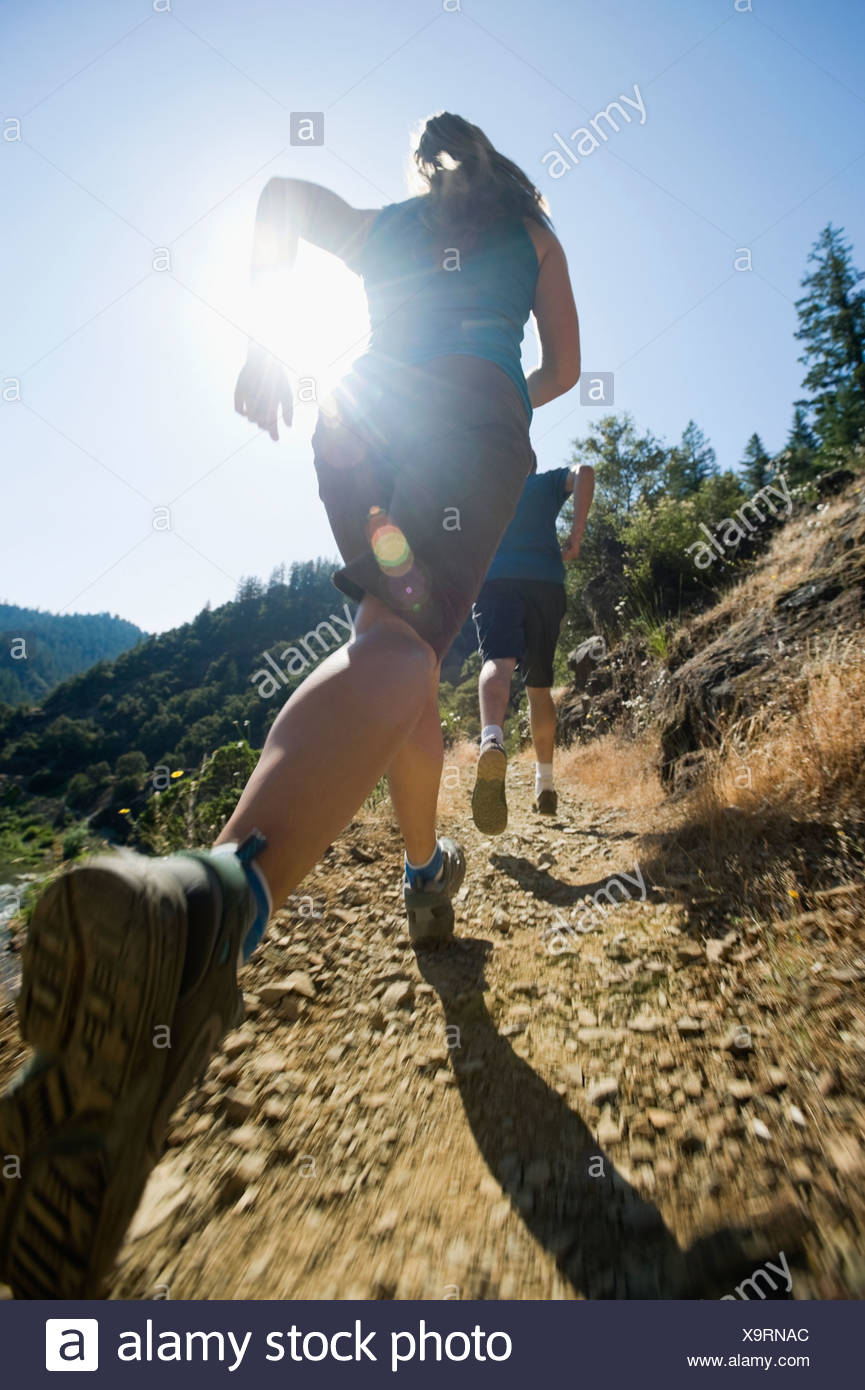 Runners on steep trail - Stock Image