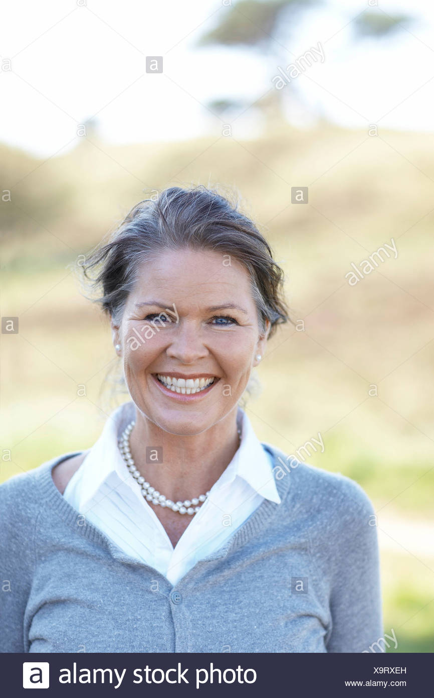 Portrait of mature beauty in nature - Stock Image