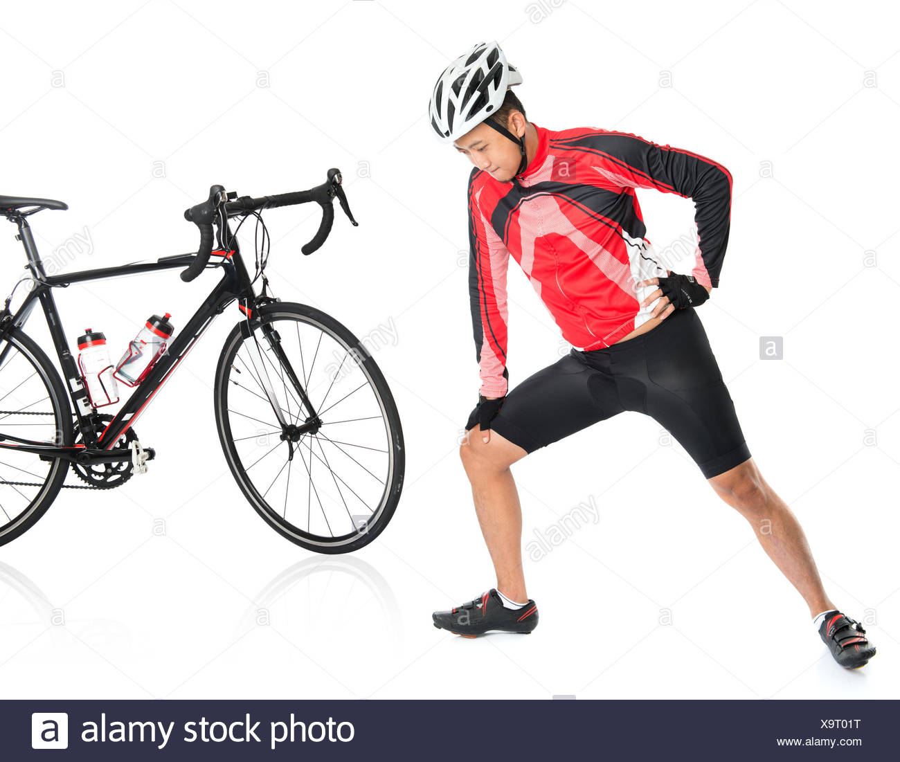Asian biker warming up or cool down, standing beside bike, isolated on white background. Stock Photo