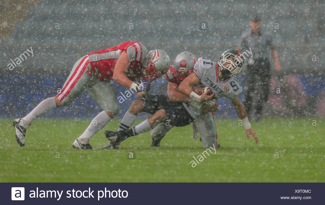WR Paul Durand, No. 12 France, is tackled by LB Paul Werner, No. 55 Austria, in the game between Austria and France, UPC Arena - Stock Image
