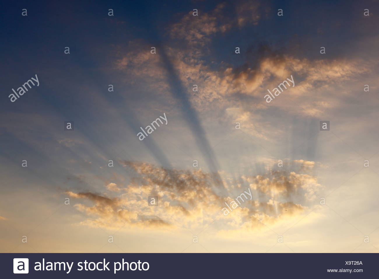 Sun rays in the cloudy sky, Ireland, Europe - Stock Image