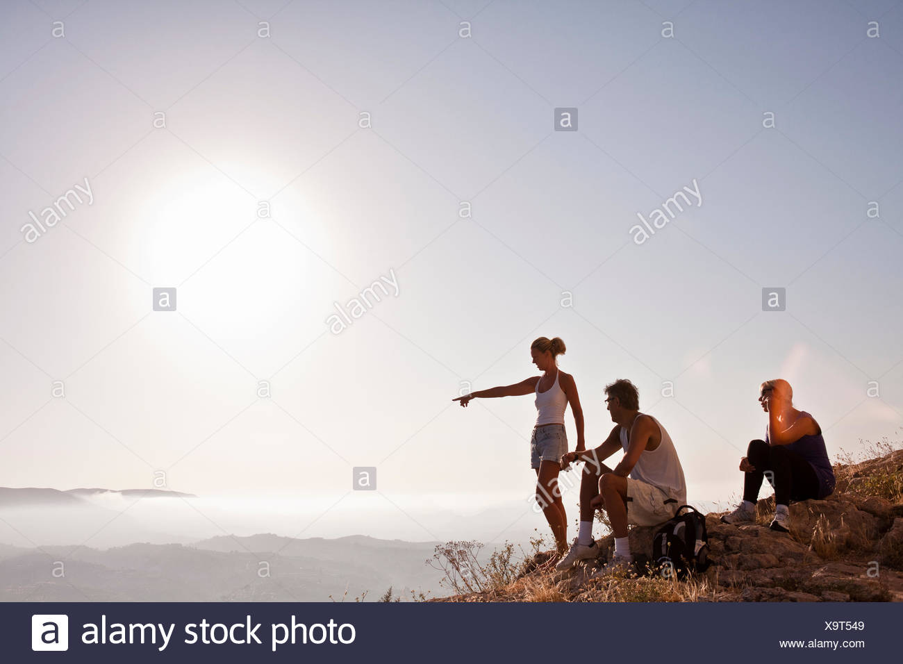 Spain, Alicante, Cocentaina, Tourists in mountains looking at view Stock Photo