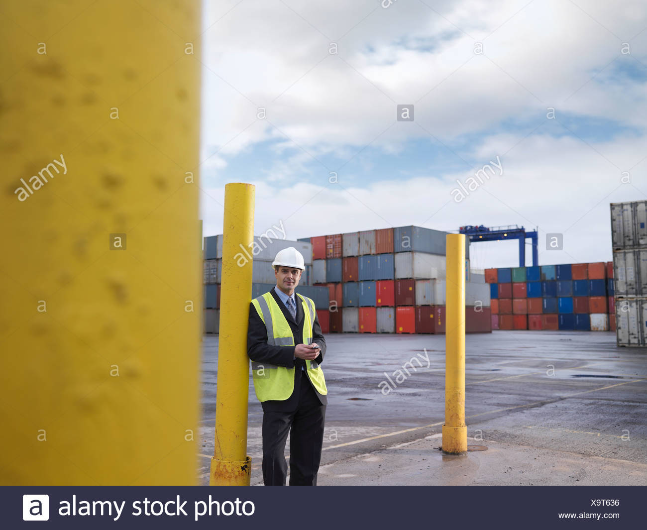 Businessman With Shipping Containers Stock Photo