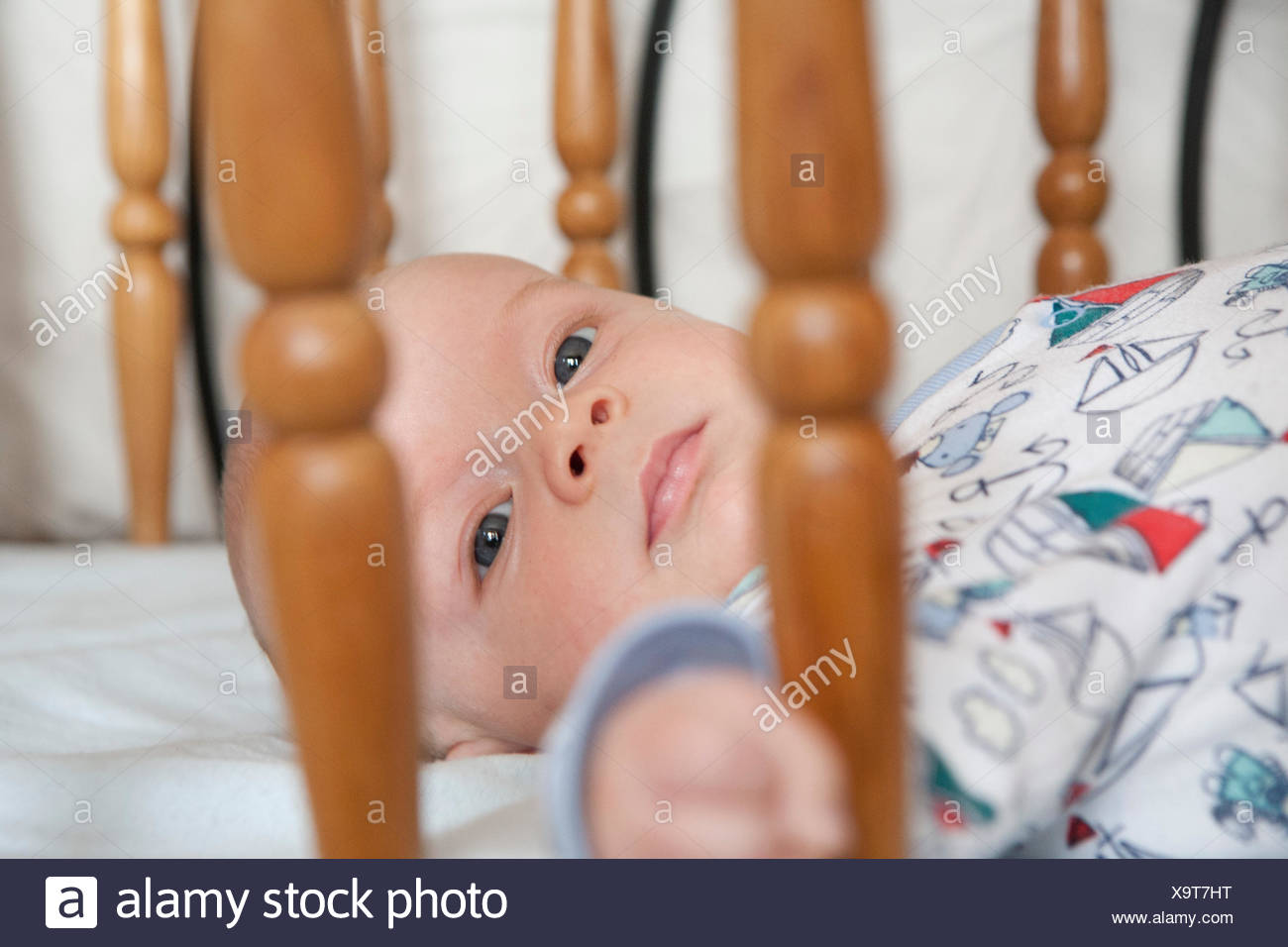 Baby in cot - Stock Image