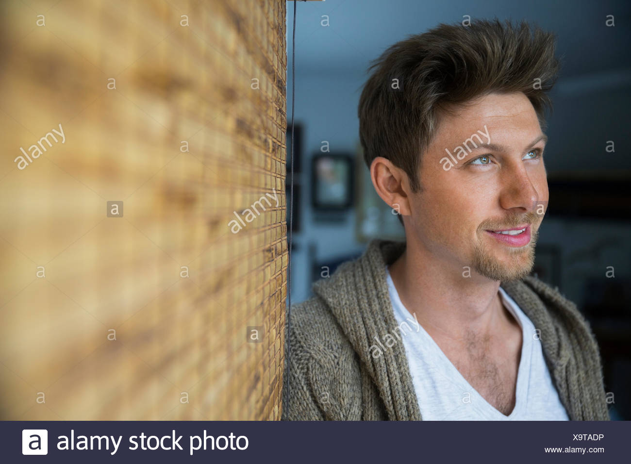 Portrait smiling brunette man looking away Stock Photo