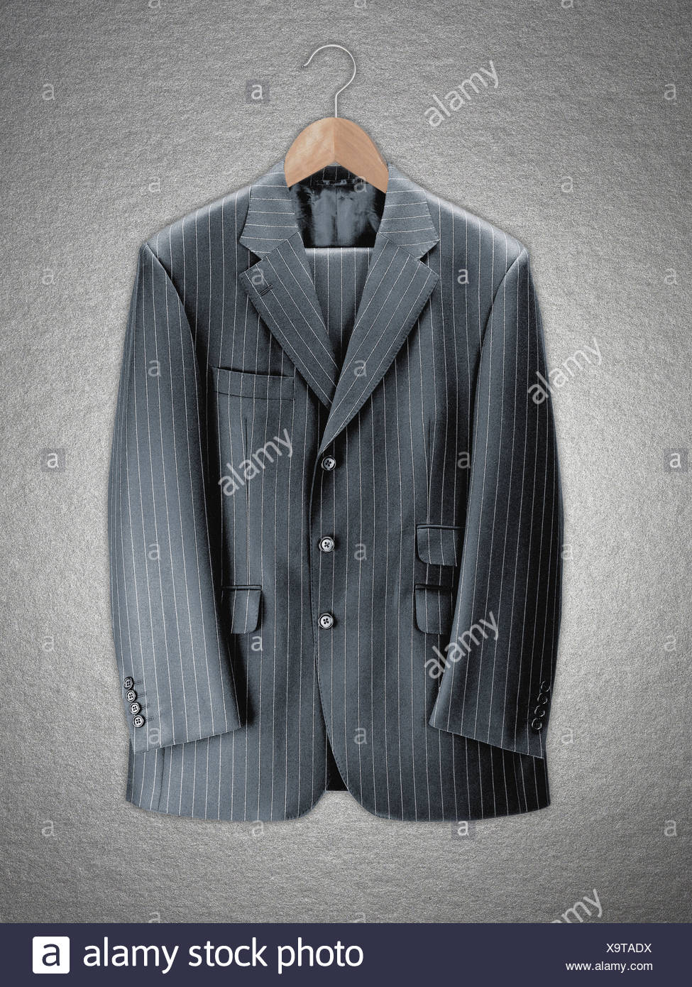 Business suit on coat hanger - Stock Image