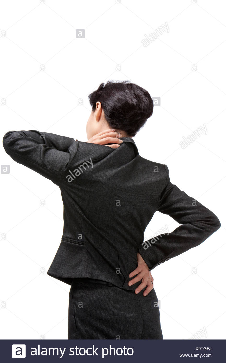 Middle-aged businesswoman suffering from backache and neck ache - Stock Image