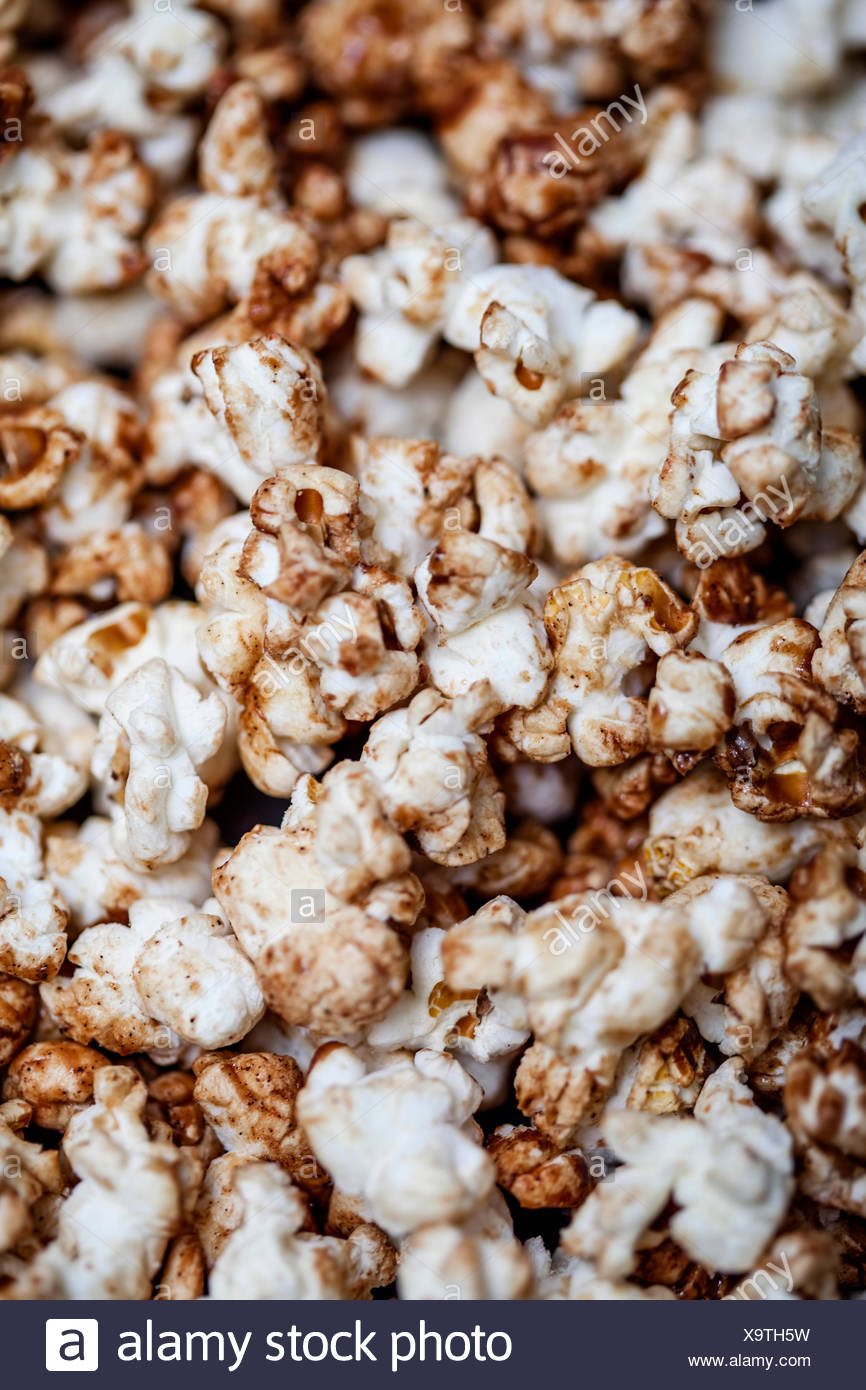 Close up shot of chocolate covered popcorn - Stock Image
