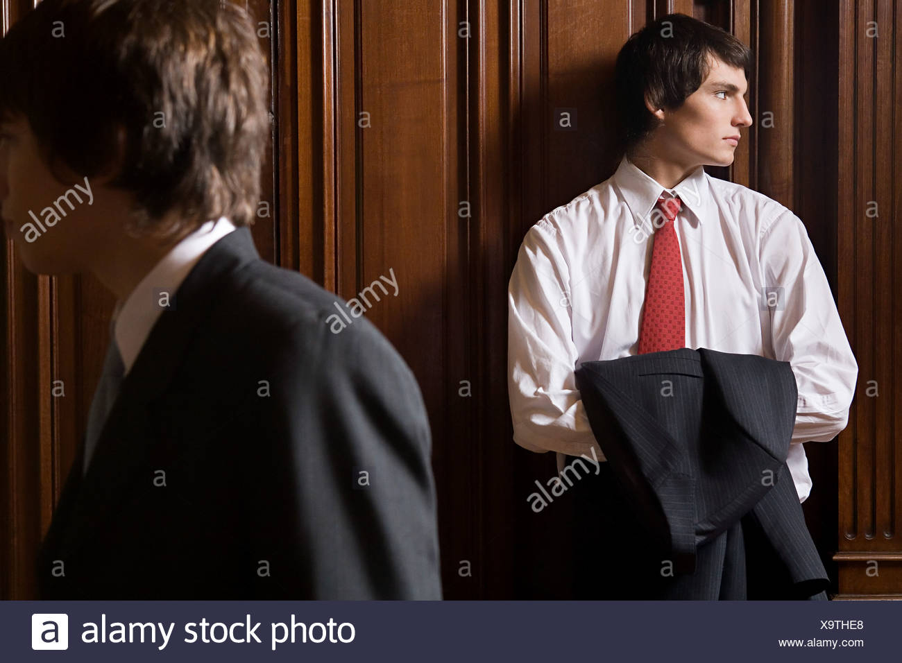 Boys wearing suits - Stock Image