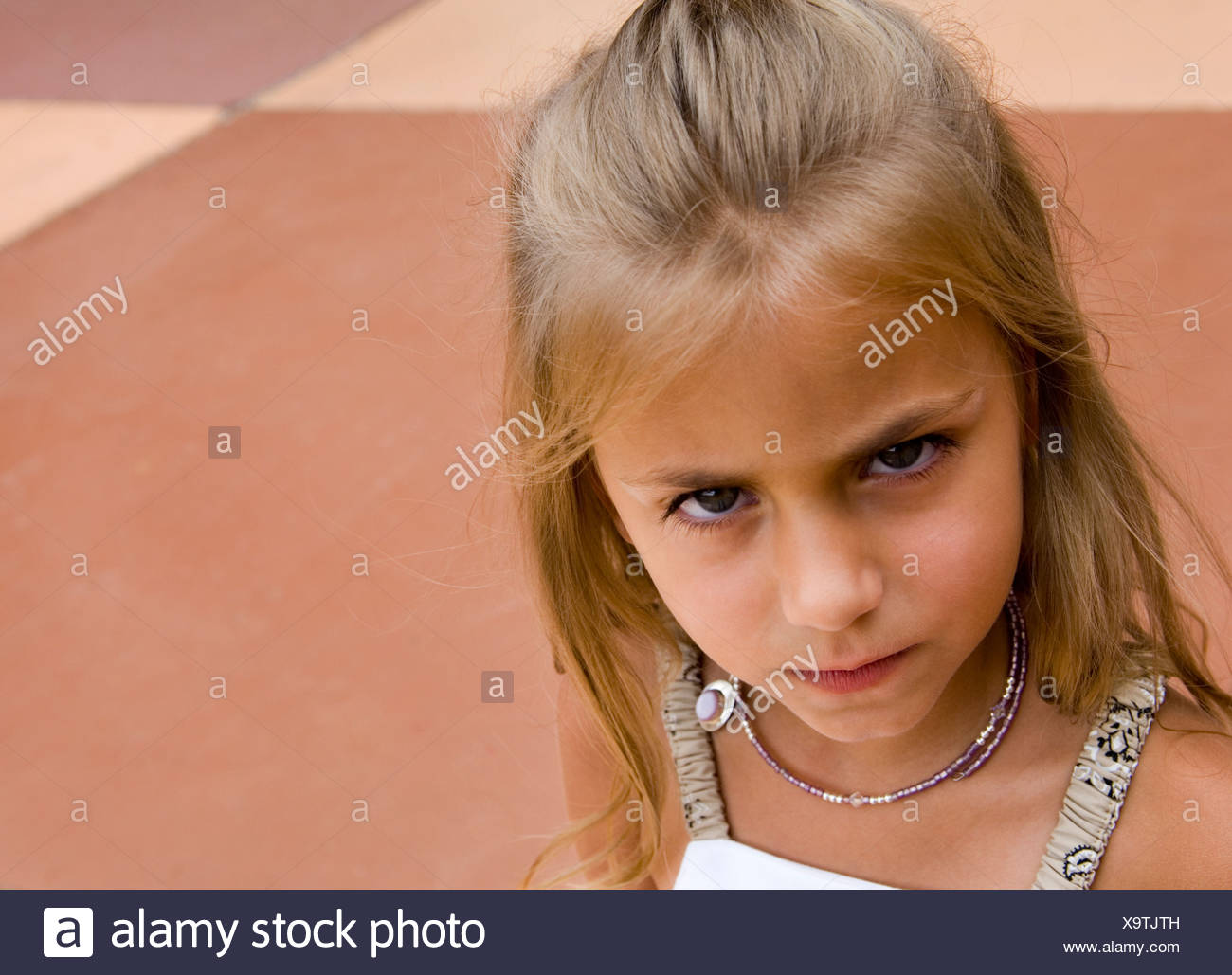 Young Scowling Girl - Stock Image