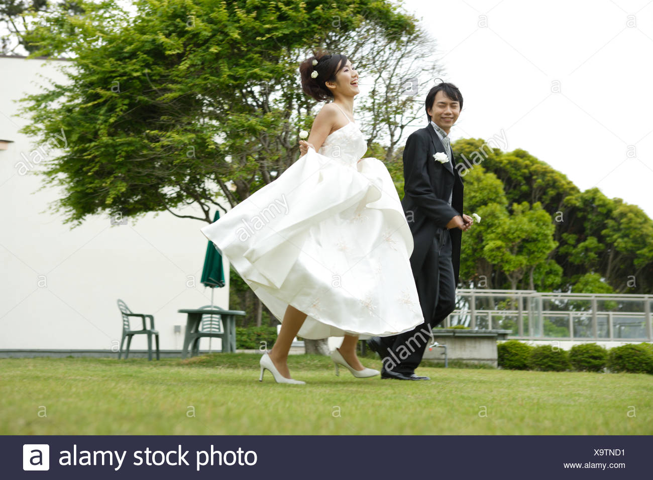 Remarkable Bride And Groom Running On Lawn Stock Photo 281441469 Alamy Download Free Architecture Designs Scobabritishbridgeorg