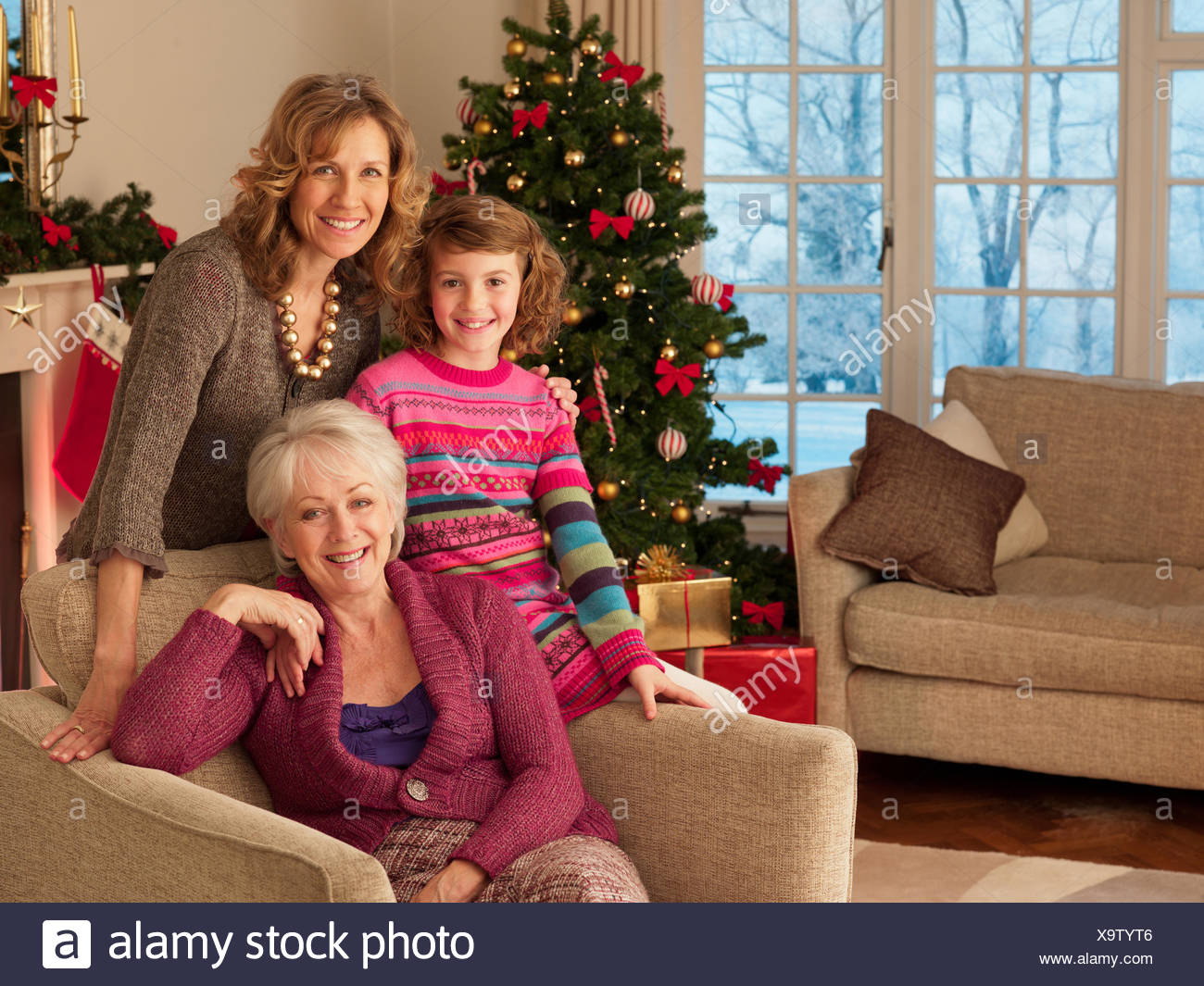 Multi-generation family near Christmas tree - Stock Image