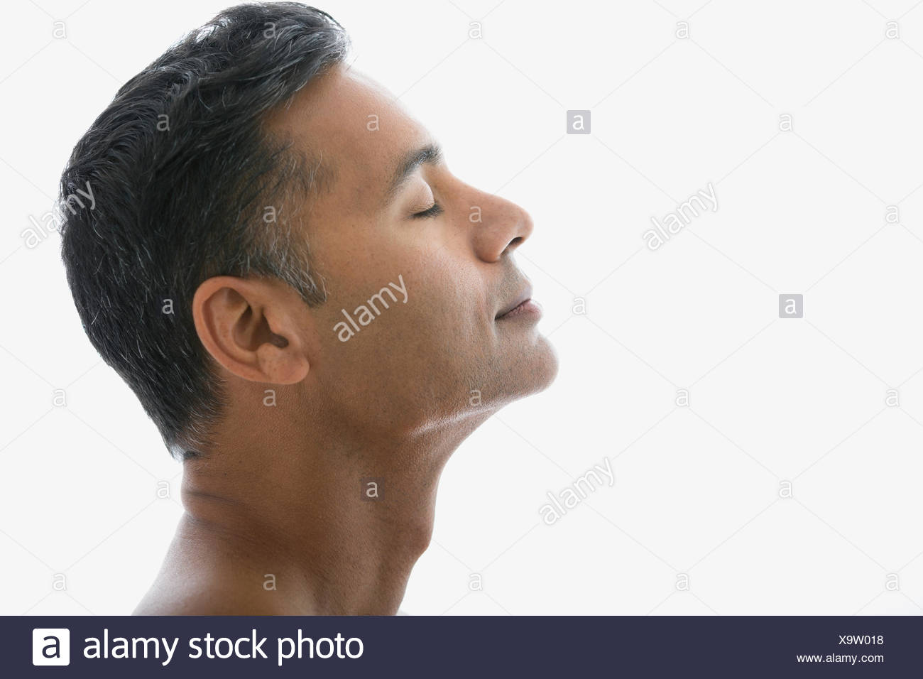 Man with head back and eyes closed - Stock Image