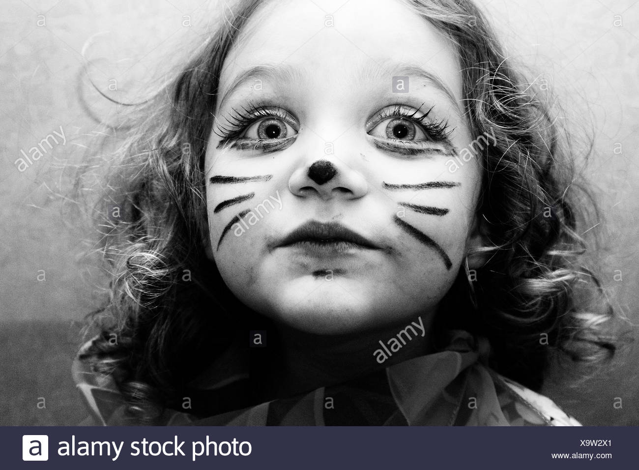 Portrait of girl (4,5) with cat face paint Stock Photo