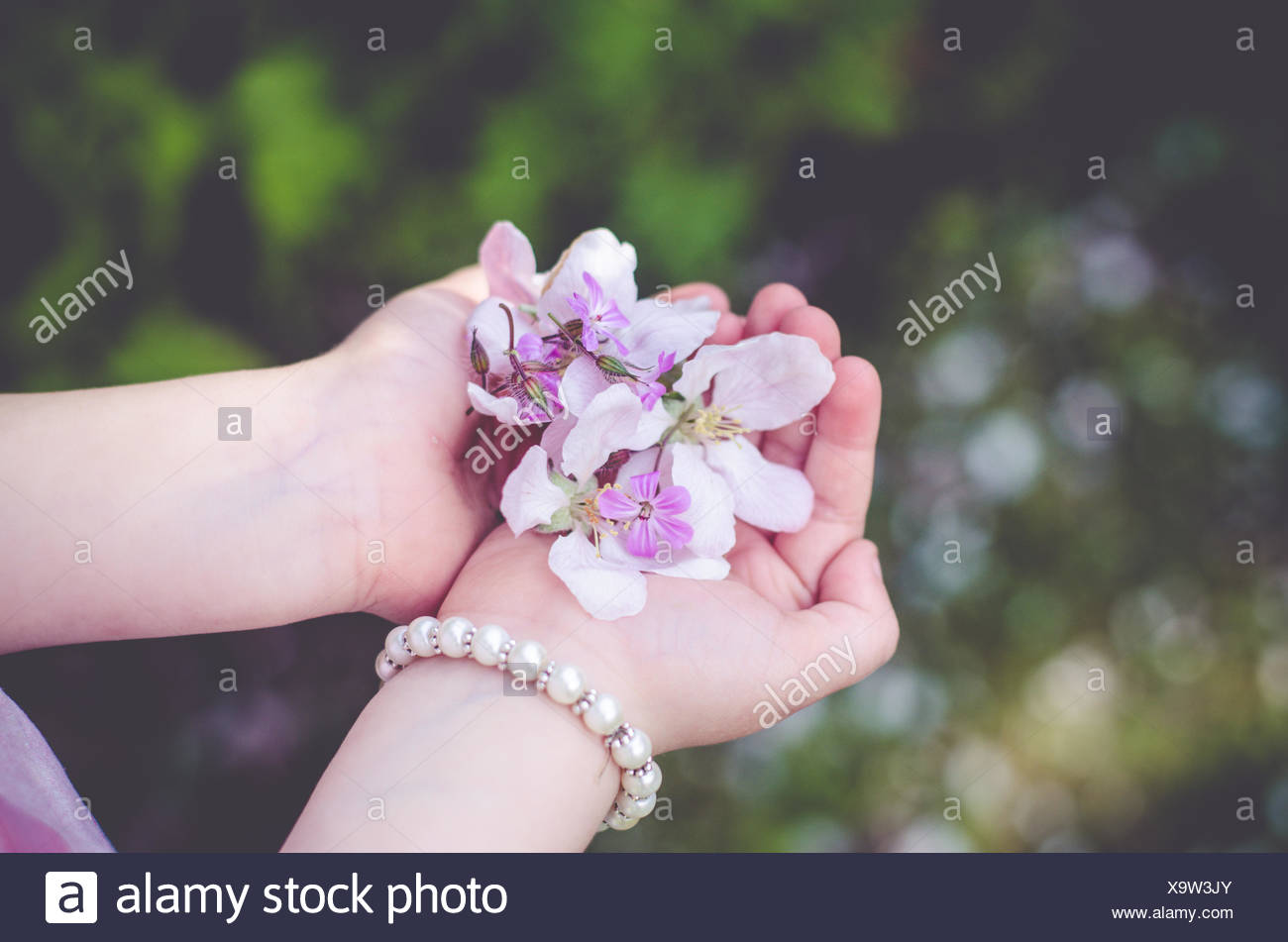 Girl with handful of flowers - Stock Image