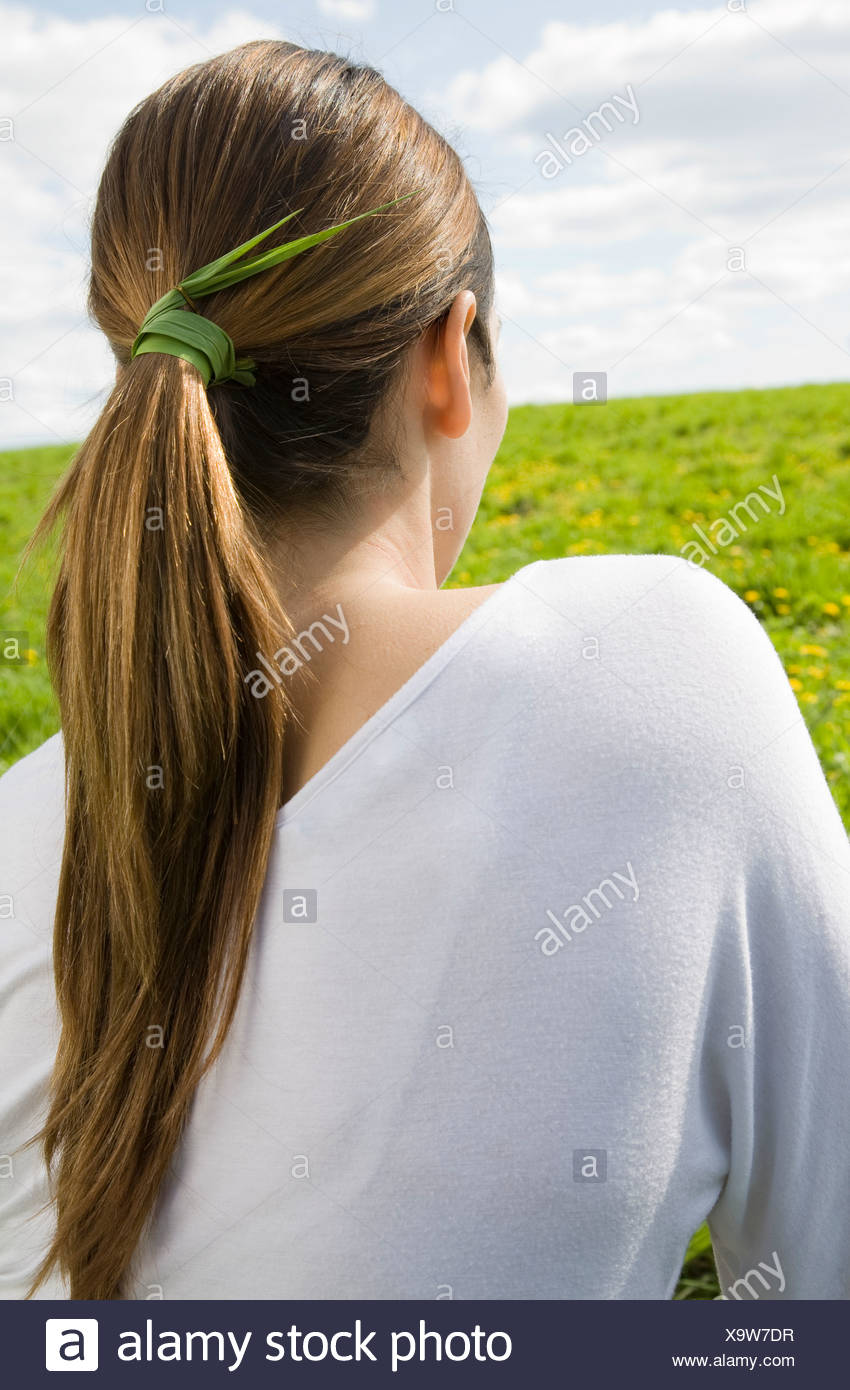 Woman with grass tied in hair - Stock Image