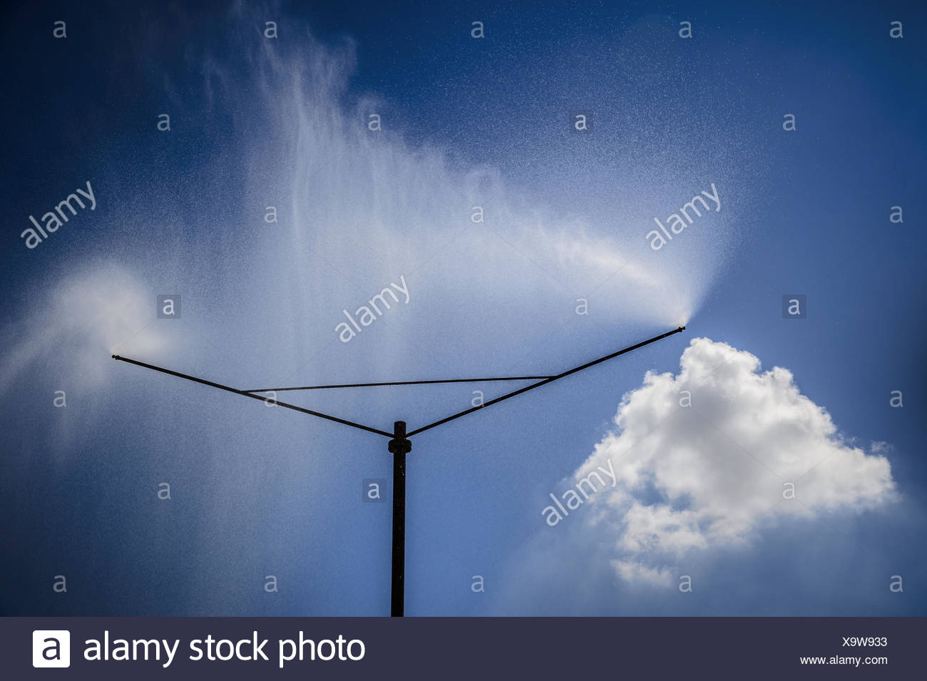 A sprinkler system sprayed a water curtain - Stock Image