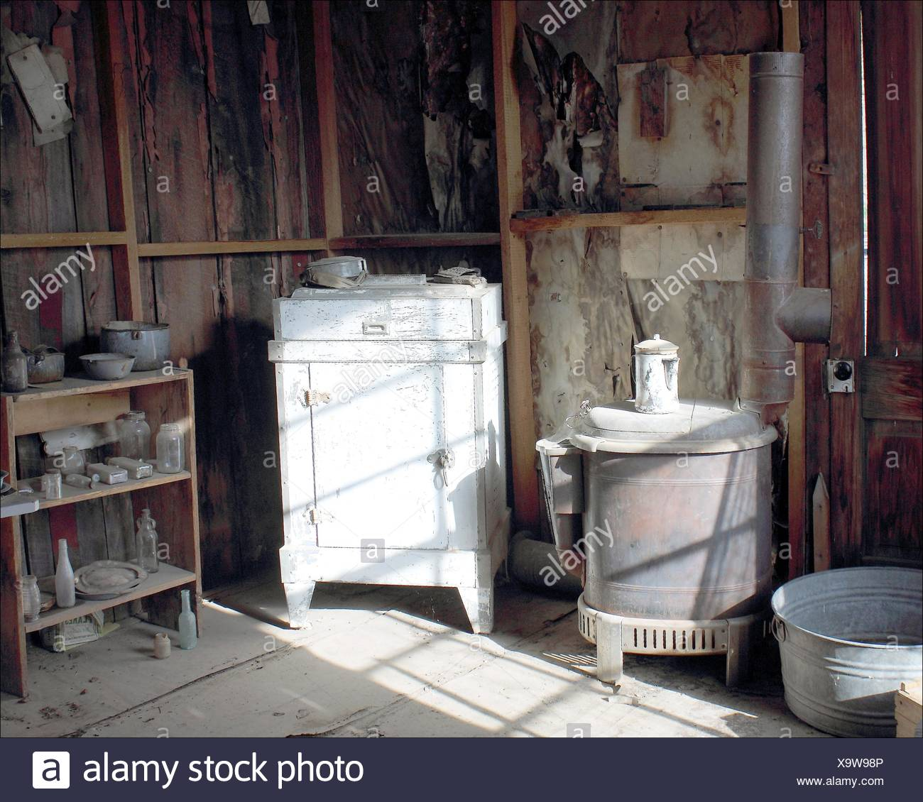This kitchen in an old cabin in Coloma, California, silently waits for its owner, possibly a miner who never found his own gold strike. - Stock Image