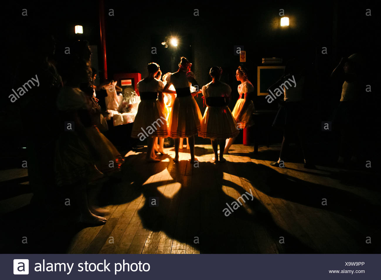 Behind the scenes. Ballet dancers before performance talk at theater dressing-room. - Stock Image