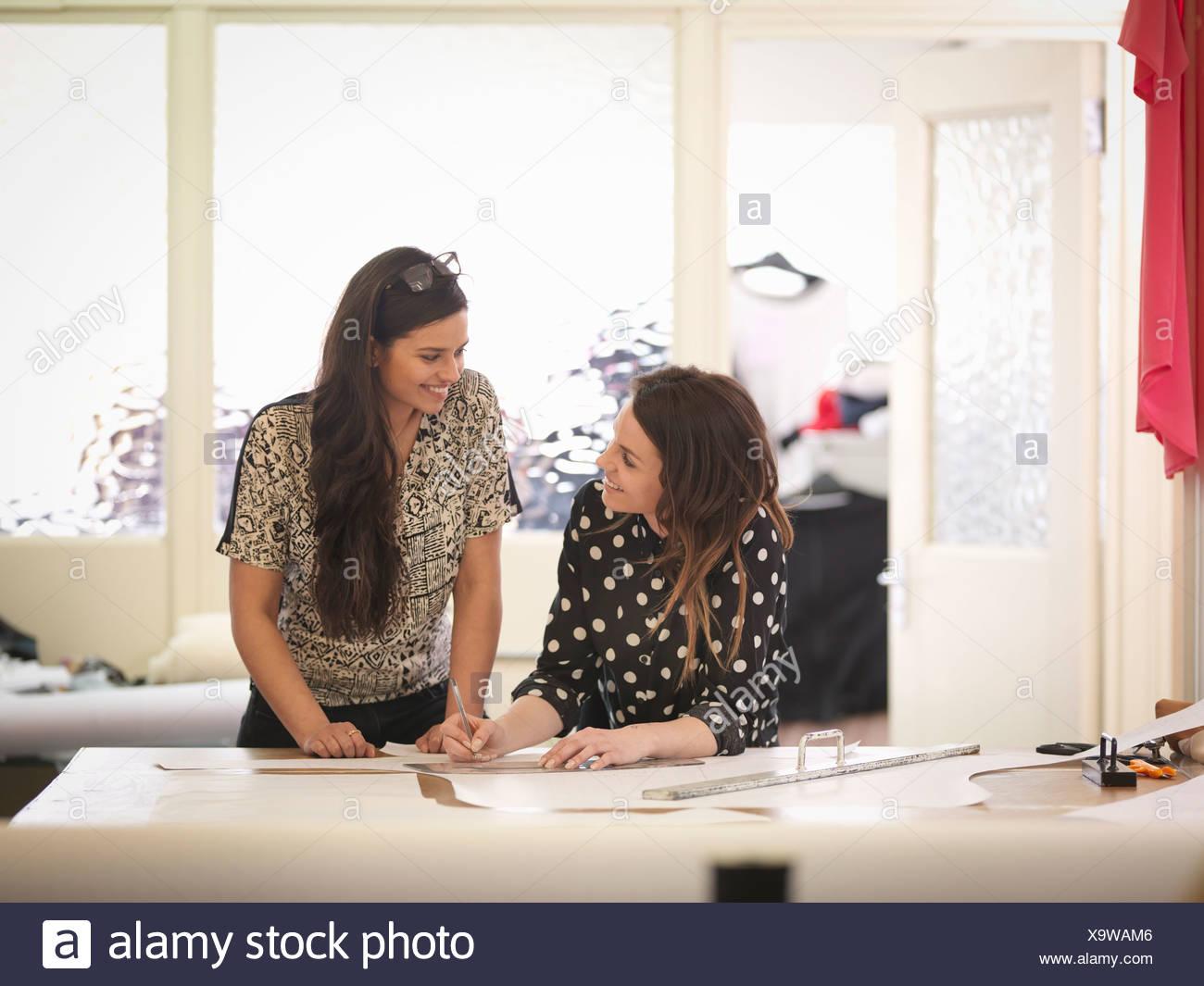 Fashion designers working together in fashion studio - Stock Image