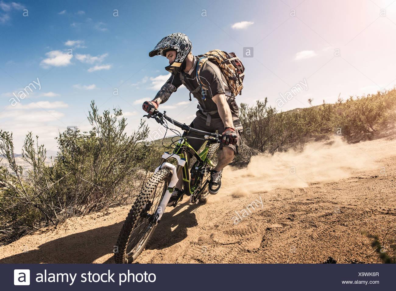 Mountain biker riding downhill - Stock Image