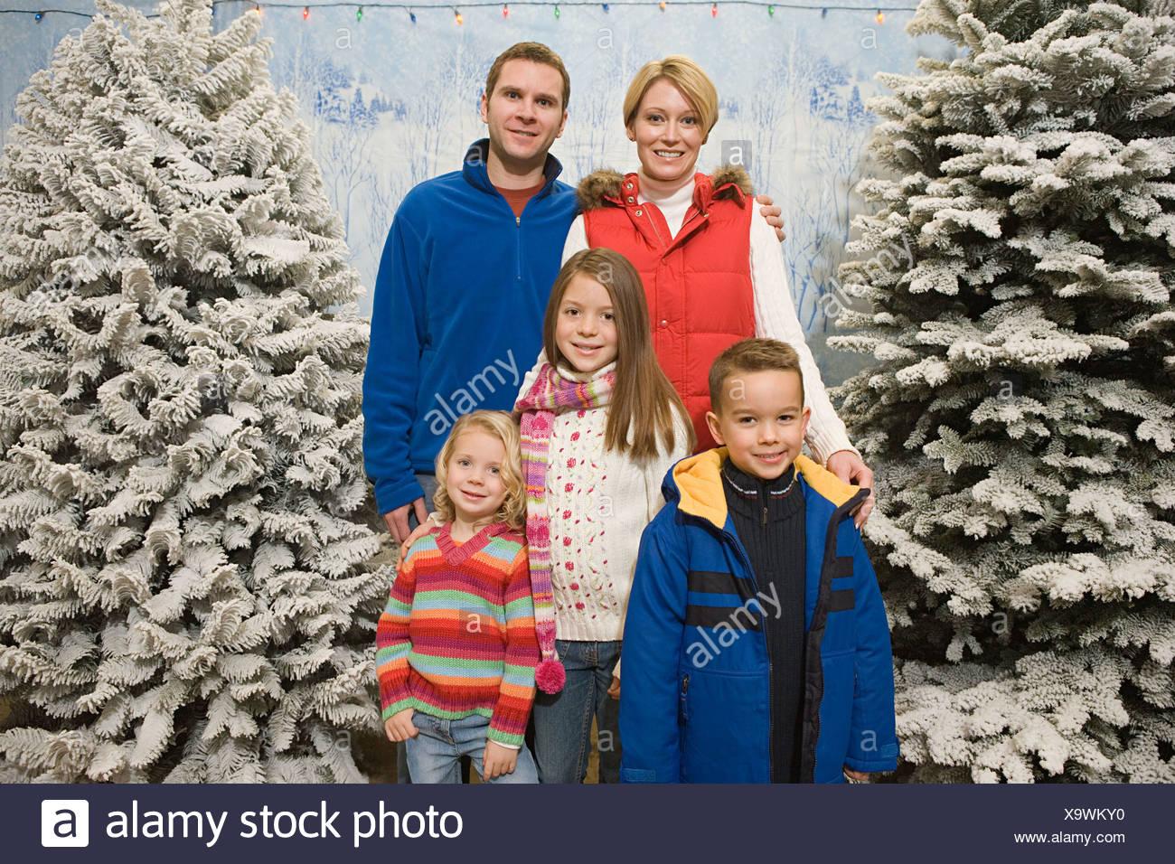 Family in winter scene - Stock Image