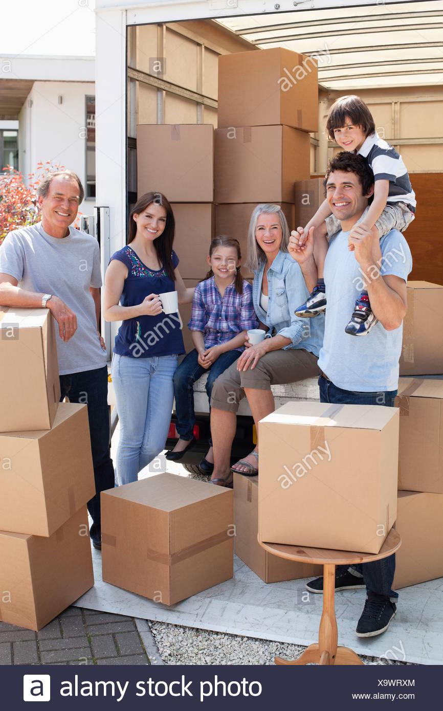 Family taking break near moving van - Stock Image