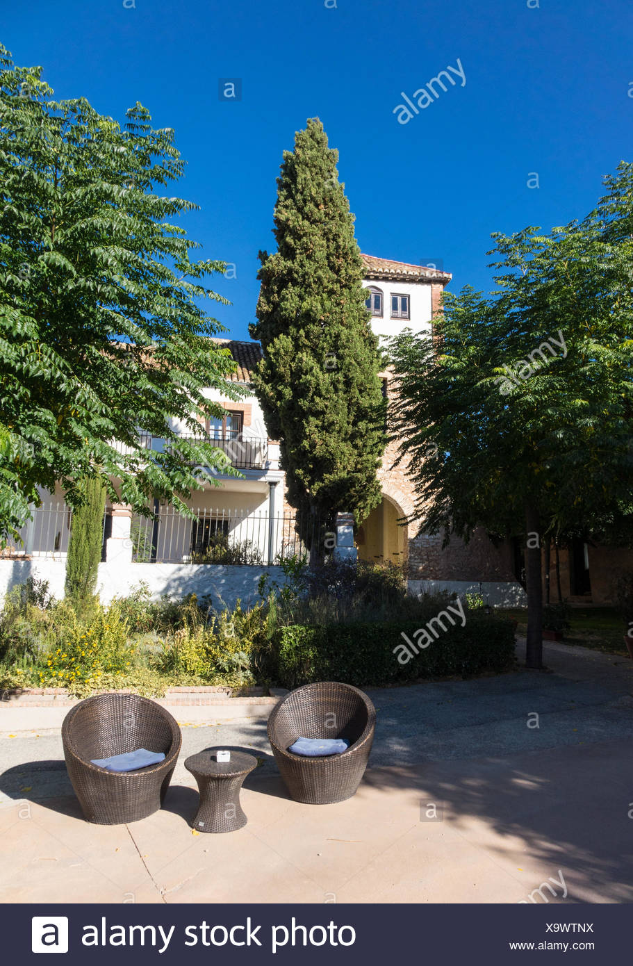 Warm courtyard with table and chairs in Spain Stock Photo