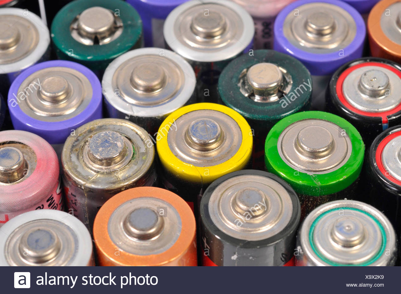 Used, empty AA and rechargeable batteries - Stock Image