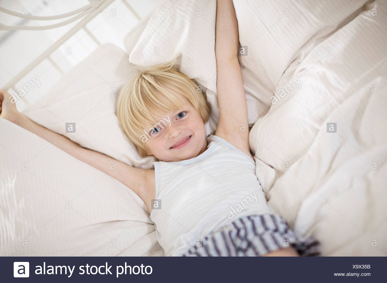 boy lying in bed Stock Photo