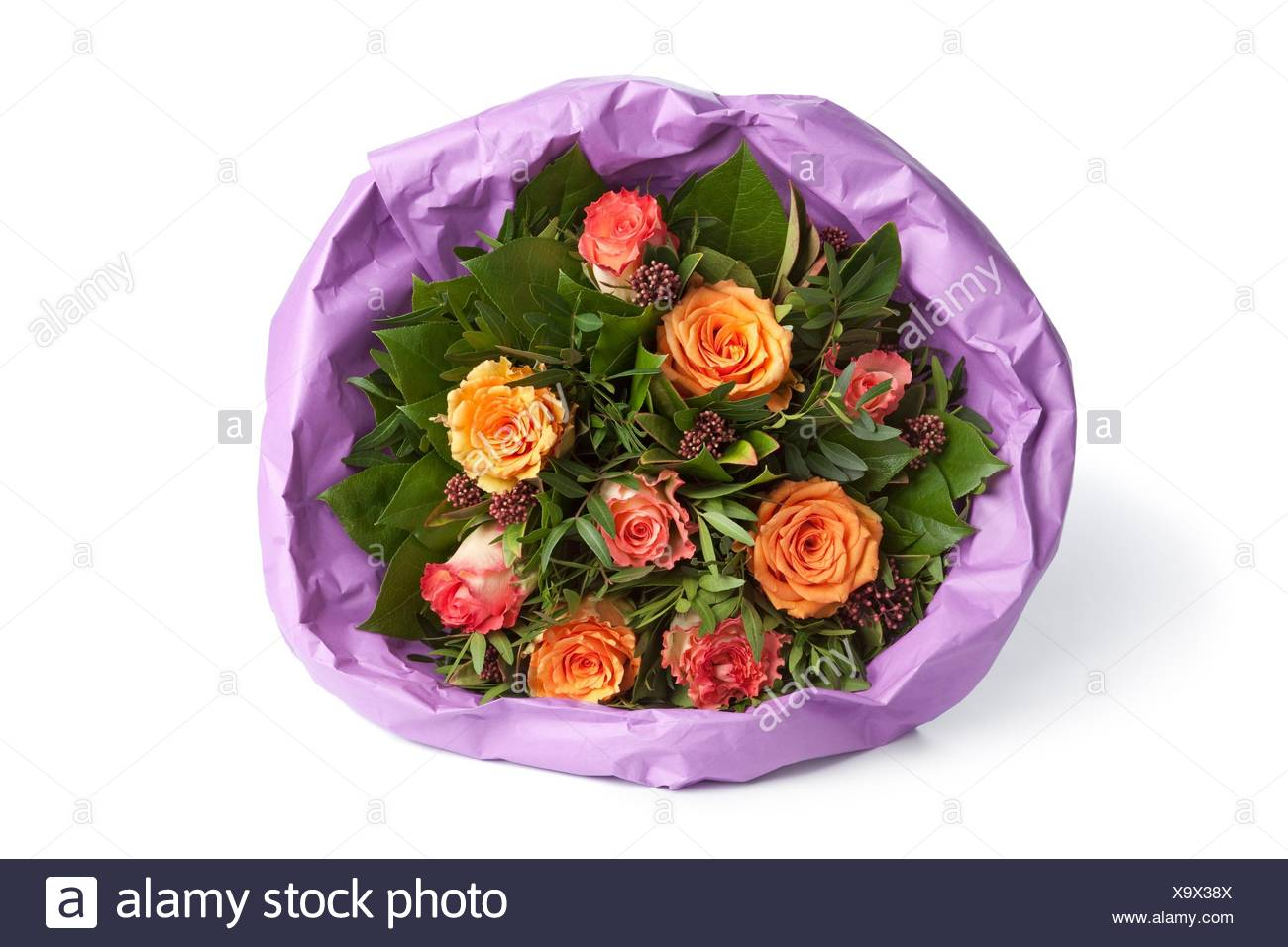 Bouquet Of Roses Wrapped In Paper On White Background Stock Photo