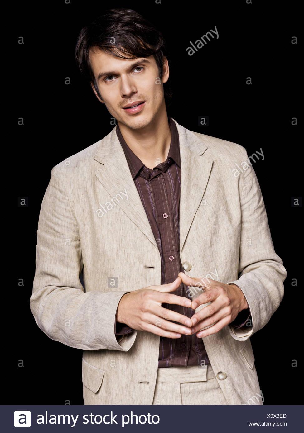Man wearing beige jacket, portrait - Stock Image