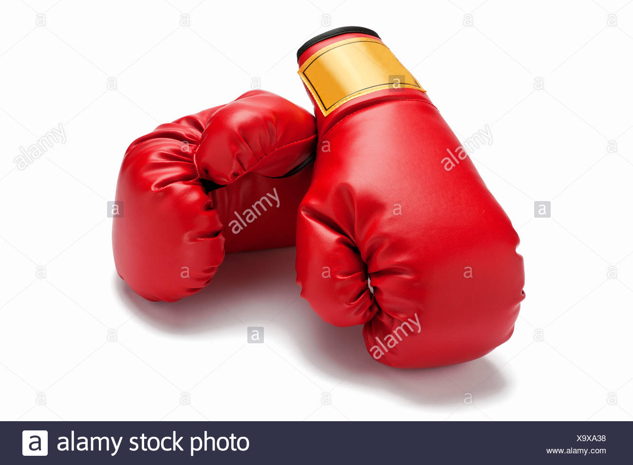 A pair of red boxing gloves - Stock Image