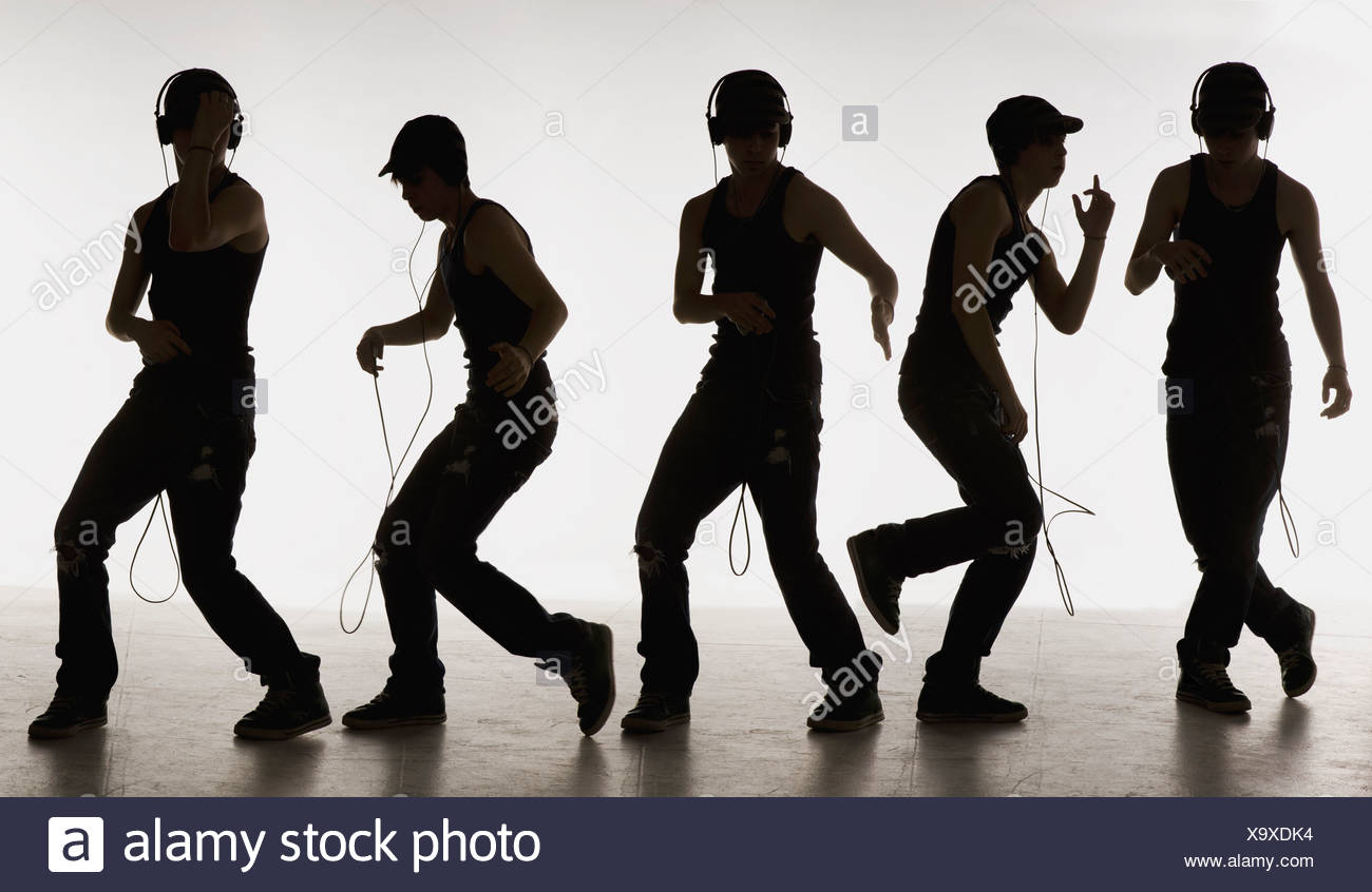 composite image of a boy dancing with headphones - Stock Image