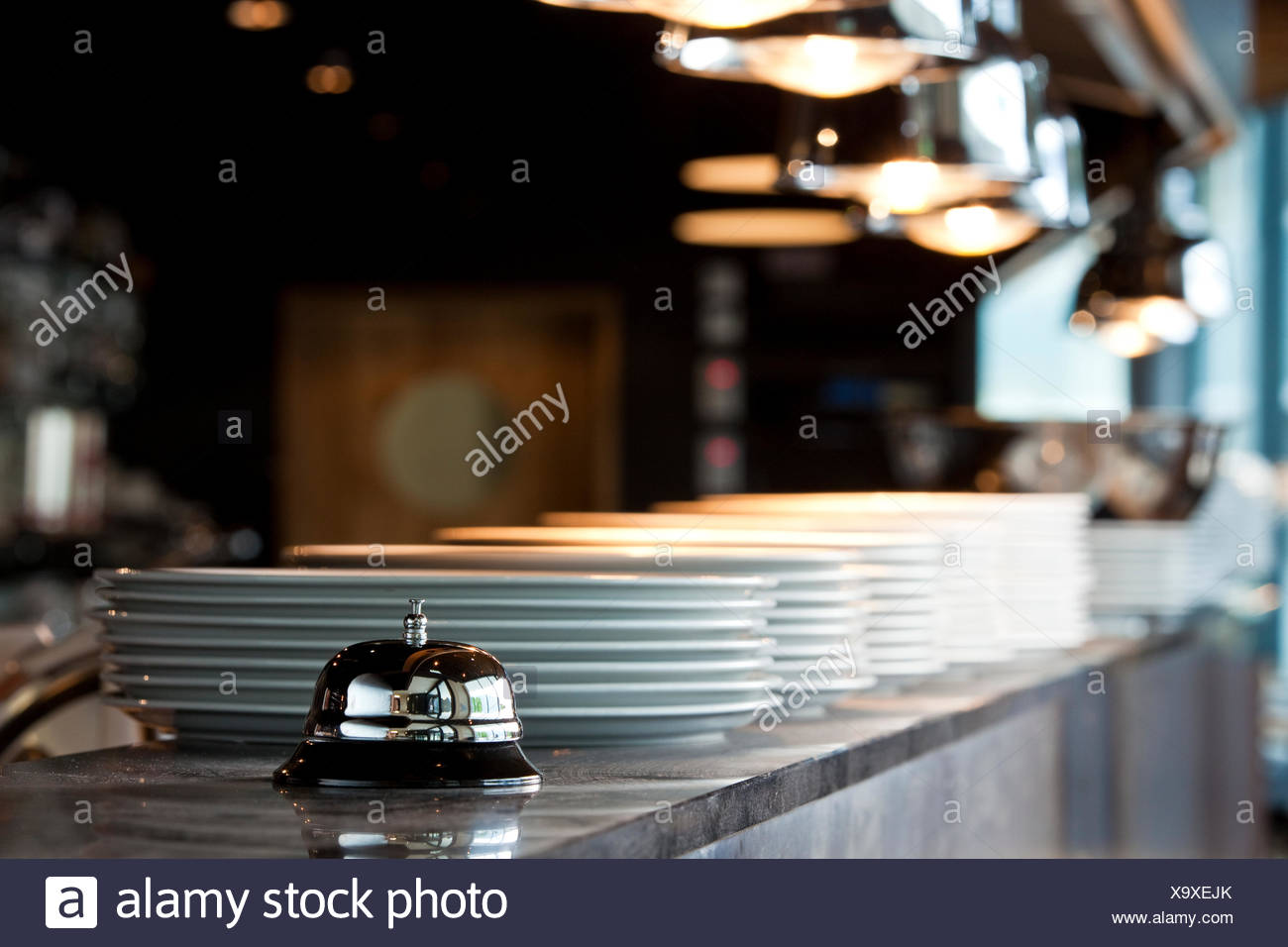 Bell on the food counter of a restaurant - Stock Image