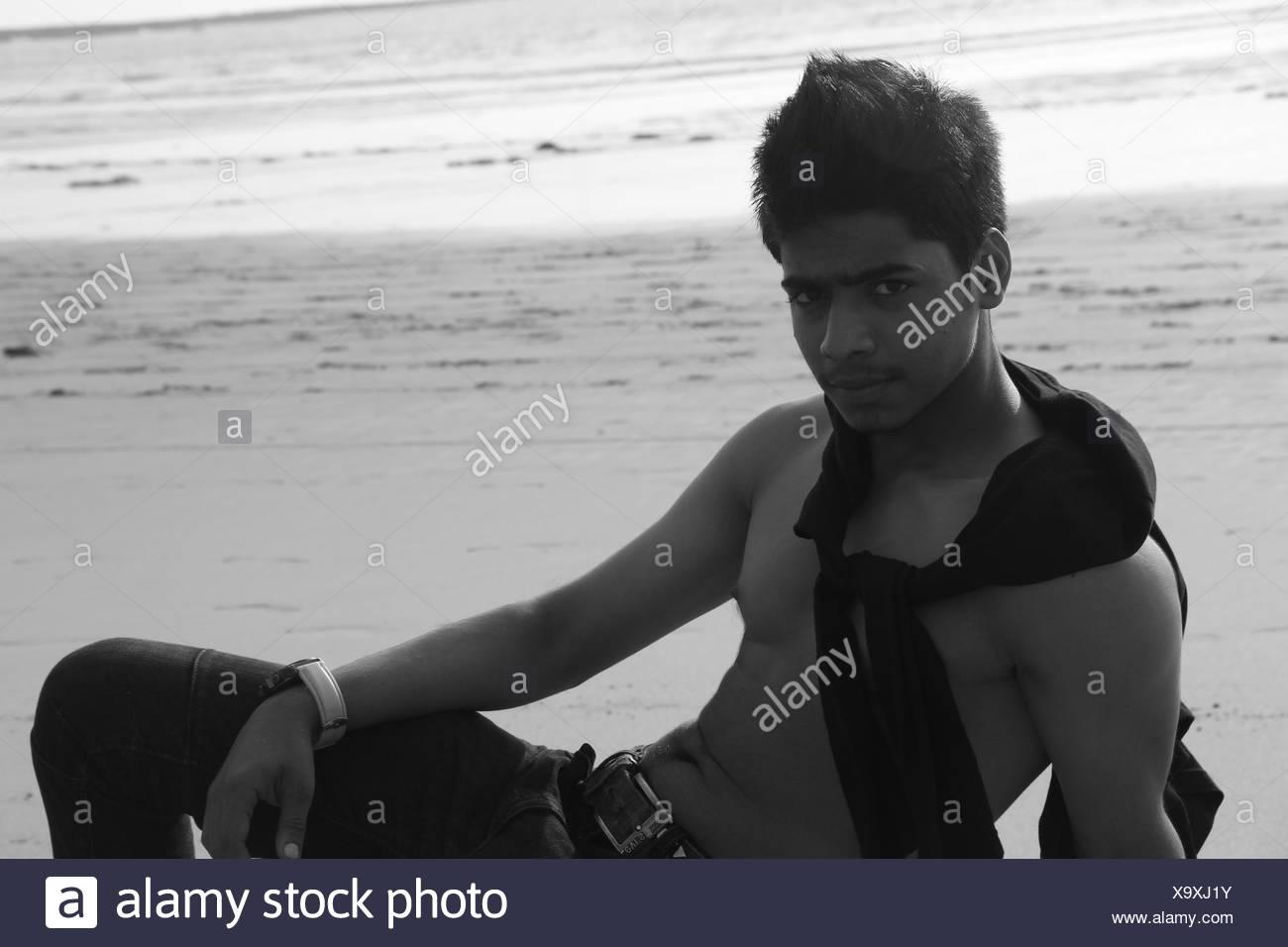 Man Posing On Beach - Stock Image
