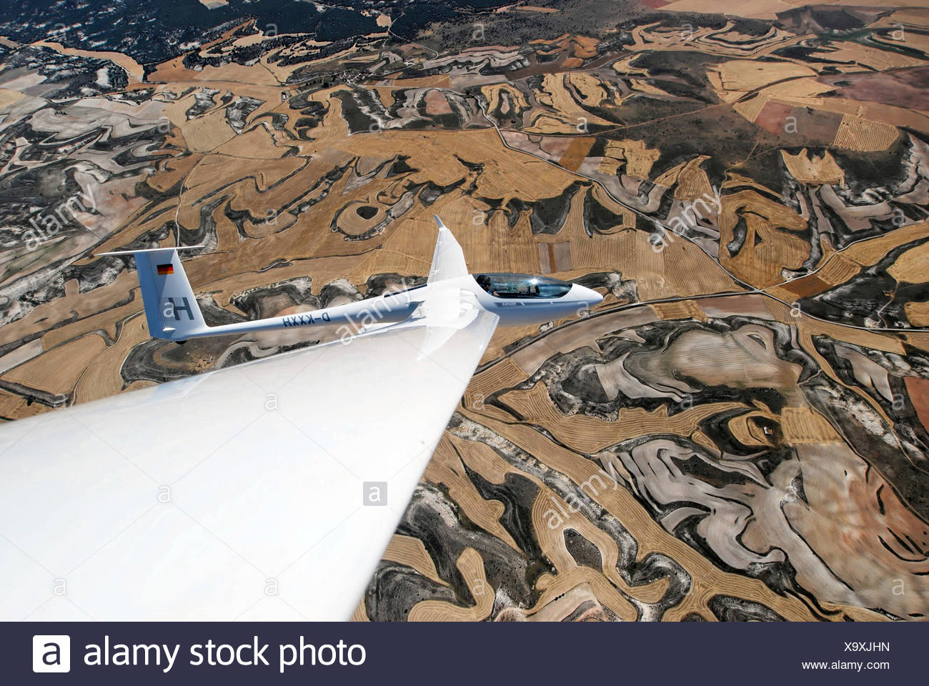 Aerial view, type ASH 26 E glider fkying over the Castillian countryside, Segovia, Castile and León, Spain Stock Photo