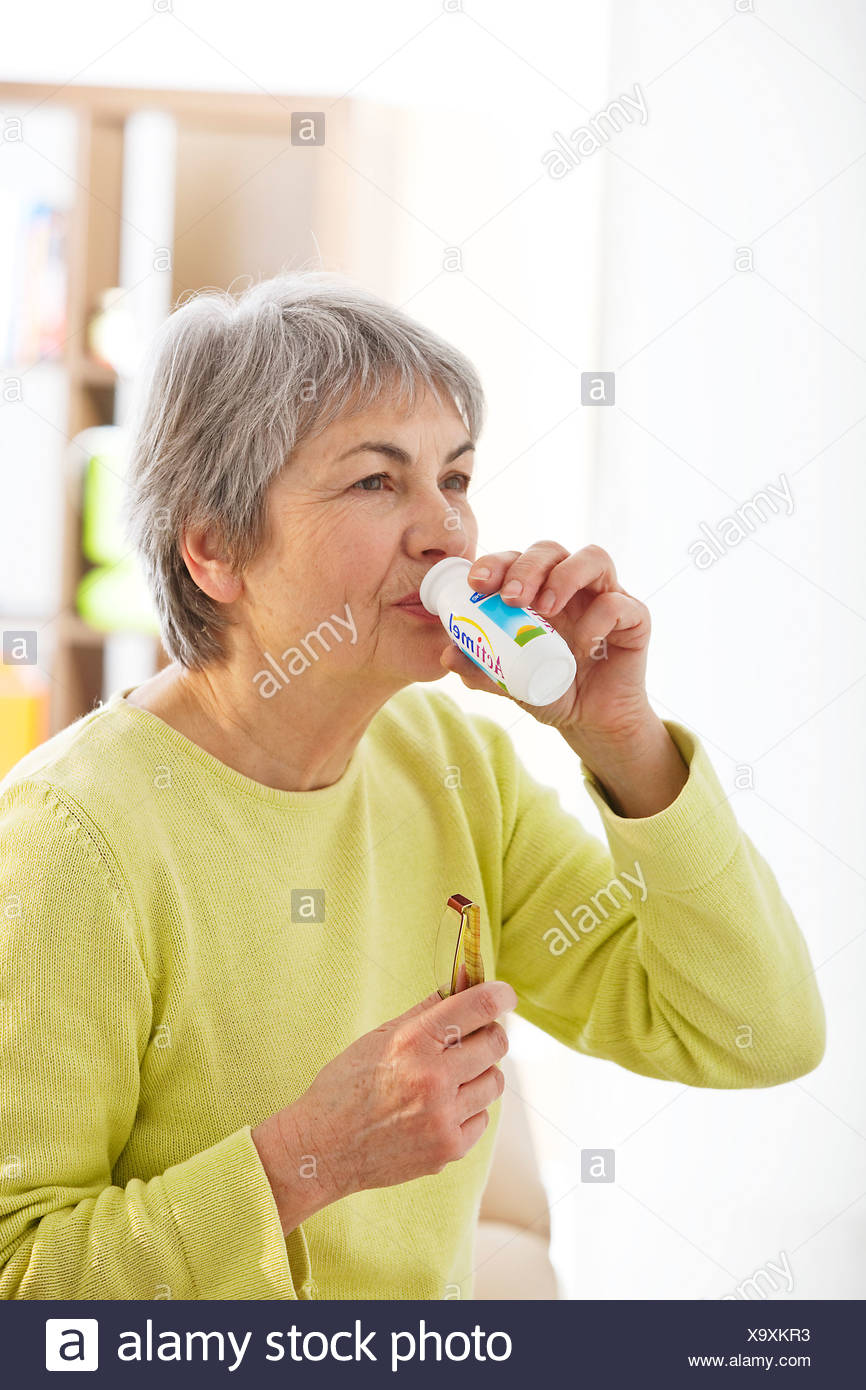 ELDERLY PERSON, DAIRY PRODUCT - Stock Image